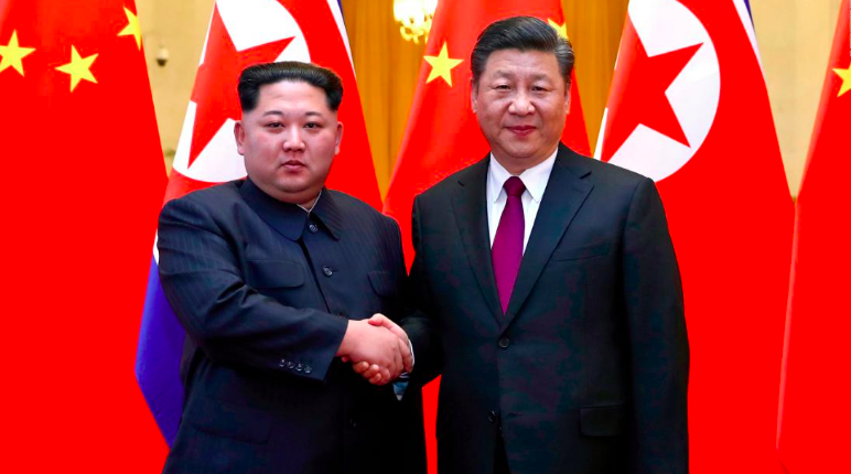 North+Korean+leader+Kim+Jong+Un+and+Chinese+President+Xi+Jinping+shake+hands+after+a+separate+meeting+of+theirs+in+March.+Kim+traveled+unannounced+to+Beijing+by+train+last+month+for+another+meeting+with+Chinese+officials.