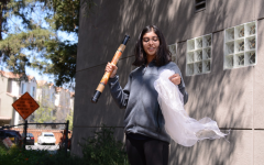 Aditi Khanna (10) waves a white scarf and shakes a rainstick to represent calling in the Spirit of the East, which represents air. Each student brought in visual representations of the element they were assigned to.