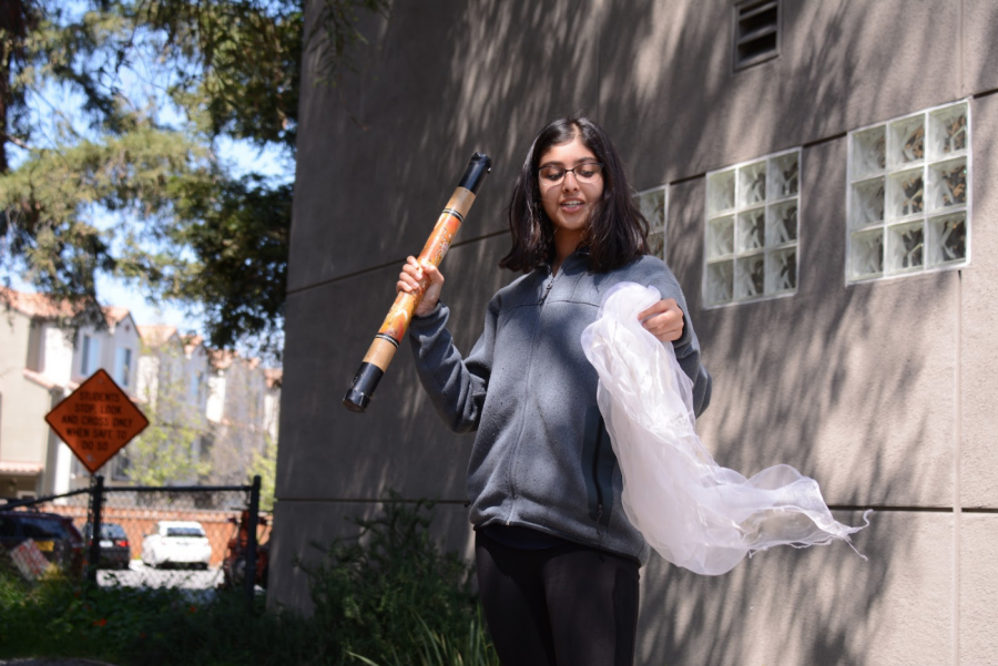 Aditi+Khanna+%2810%29+waves+a+white+scarf+and+shakes+a+rainstick+to+represent+calling+in+the+Spirit+of+the+East%2C+which+represents+air.+Each+student+brought+in+visual+representations+of+the+element+they+were+assigned+to.