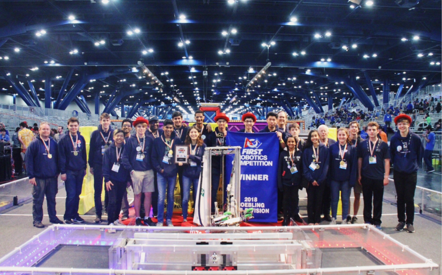 The Harker Robotics Team poses next to their robot after winning the Roebling subdivision. The FIRST Robotics Competition took place from Apr. 18 to 21 in Houston, Texas.