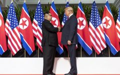 Donald Trump and Kim Jong Un shake hands at the beginning of their summit in Singapore.