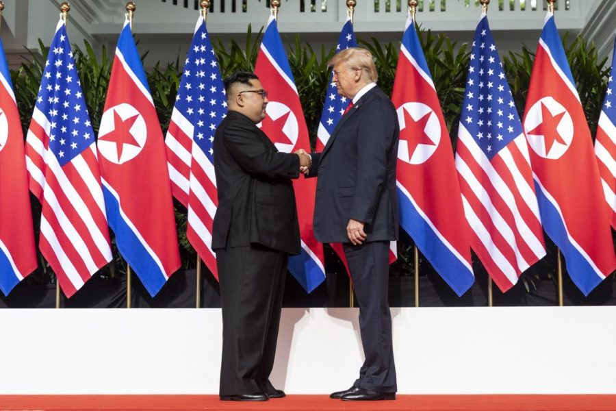 Donald+Trump+and+Kim+Jong+Un+shake+hands+at+the+beginning+of+their+summit+in+Singapore.