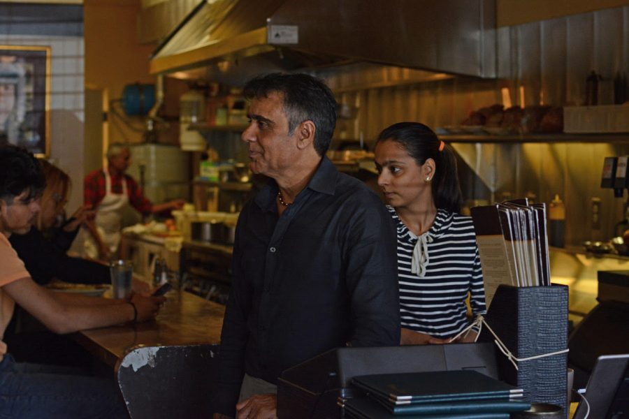 Kumar and an employee chat with a customer. The restaurant is named after Kumar's late brother-in-law, Avatar Ubhi.