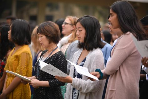Freshman adviser Yumiko Aridomi and members of the class of 2022 recite the matriculation oath at the matriculation ceremony in the upper school's quad on Aug. 24.