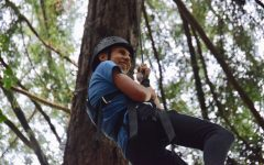 High up in the treetops, a member of the class of 2021 grips a rope for support during the sophomores' ropes course trip in the Santa Cruz Mountains on Aug. 23. The classes of 2020 and 2021 participated in off-campus trips on Aug. 23.