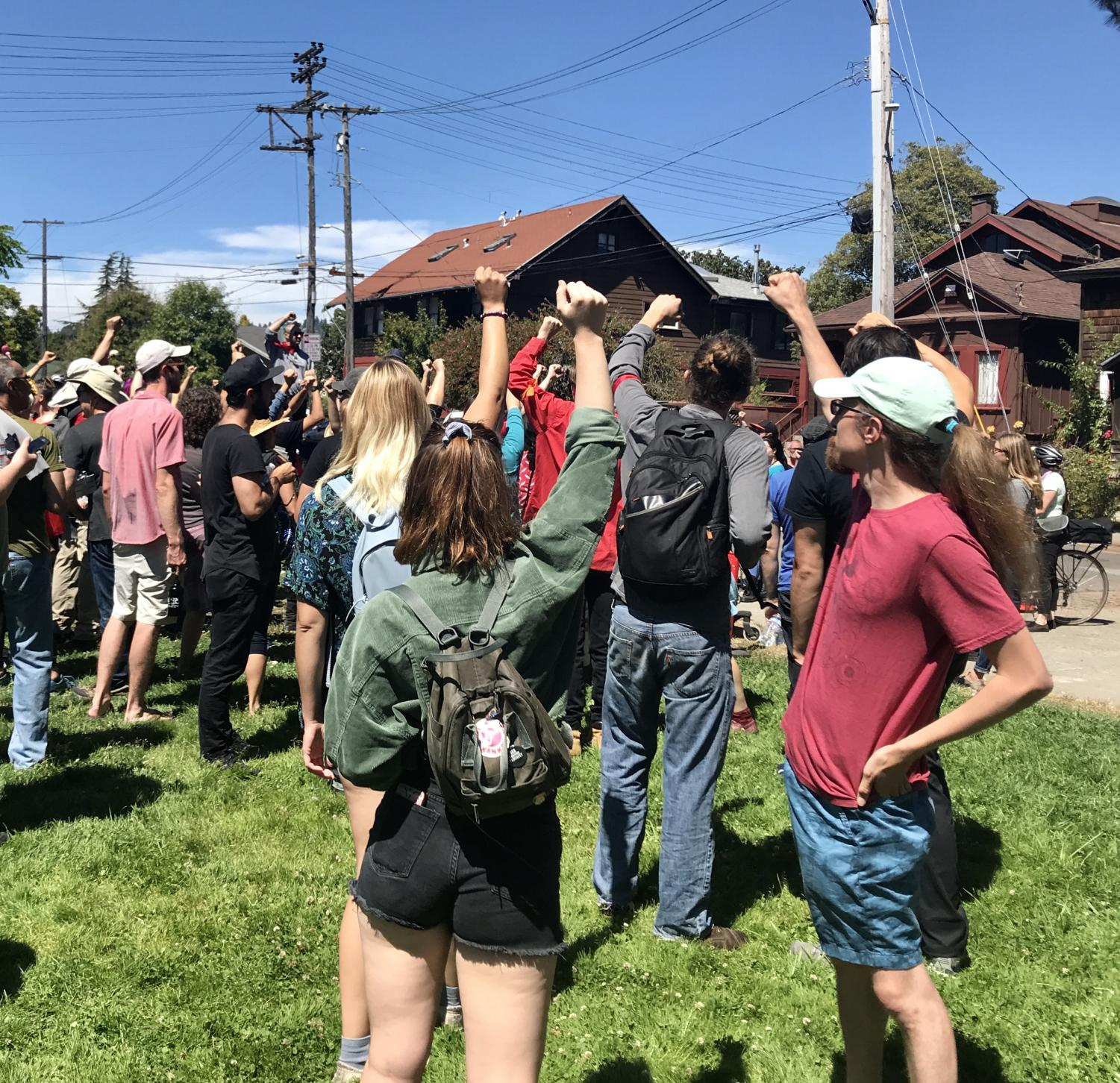 """Counter-protesters raise their fists at the """"No to Marxism in America 2"""" rally in Berkeley on Aug. 5. """"[The counter protest is] about making sure that working class people have solidarity,"""" said Khawer Khan, one of the counter-protesters."""
