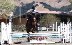 Nilisha Baid (10) and her horse Manny jump over a hurdle. After years of developing skills and enjoying horses, Nilisha joined the competitive program for horseback riding last year.