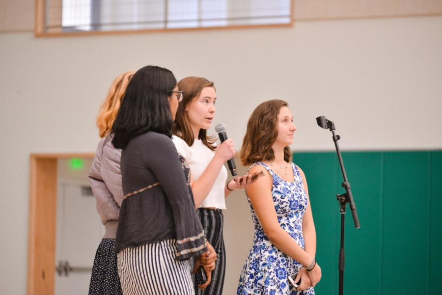 Student director Ellie Lang-Ree (12) announces her play at school meeting on Sept. 14. The four 2018 SDS directors are seniors Neha Premkumar, Emmy Huchley, Dilara Ezer and Ellie.