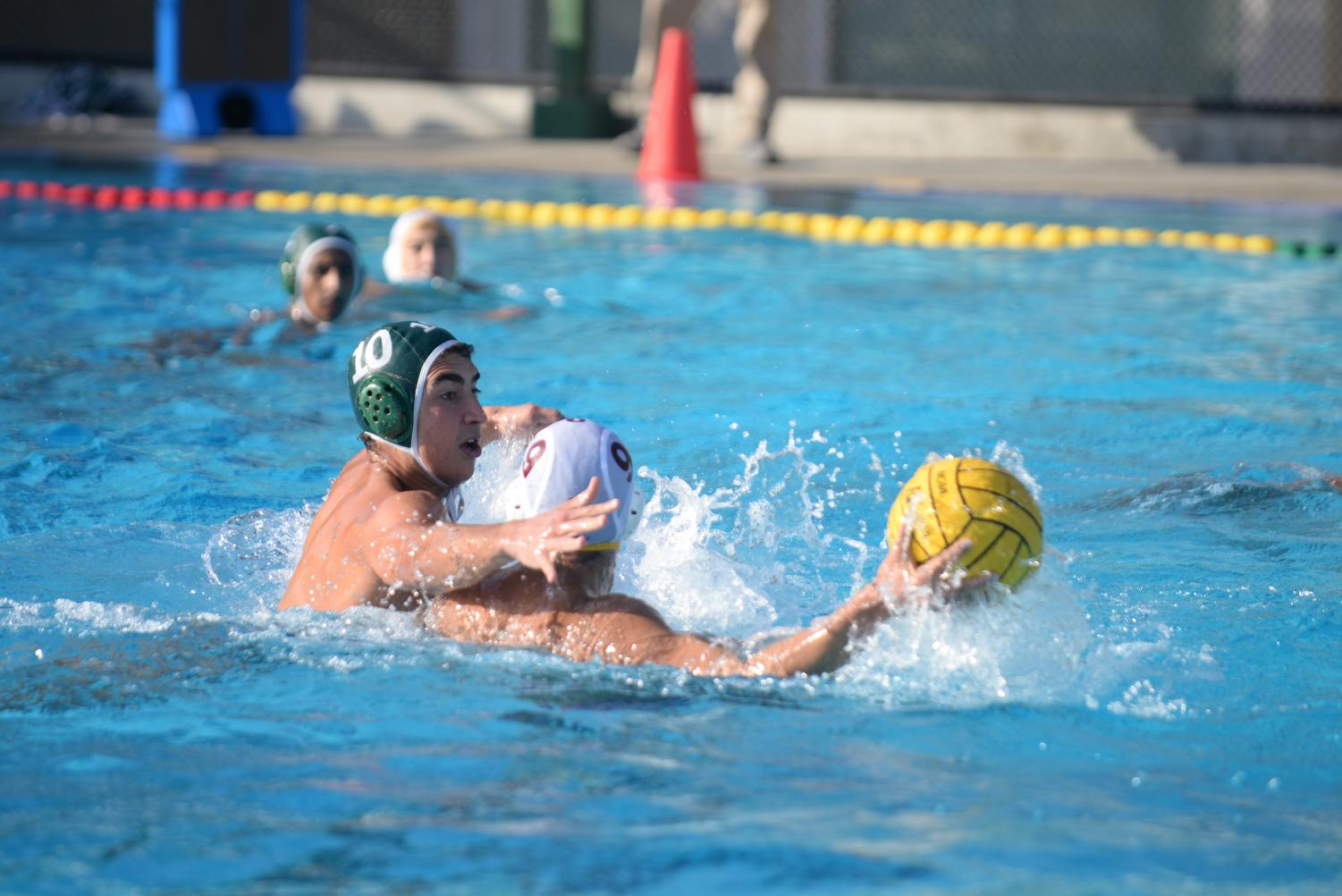 Matthew Hajjar (12) reaches for the ball, playing defense against a Cupertino player.  The first half finished 6-3 in favor of the Eagles, with Harker goals scored by Bobby and Matthew.