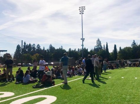 Upper school students and faculty evacuate to Davis Field at the sound of the alarm during lunch today.