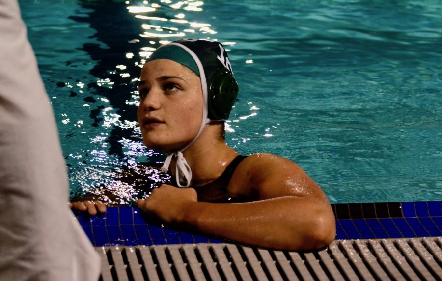 Abigail+Wisdom+talks+to+a+coach+during+a+game.+%22After+we+won%2C+everyone+sprinted+out+of+the+water%2C+and+we+pushed+our+coach+into+the+pool.+Some+of+the+seniors+got+emotional+because+it+meant+a+lot+to+win+leagues+for+the+first+time+in+a+few+years+and+to+just+see+how+far+the+team+has+come%2C%E2%80%9D+Elizabeth+Fields+%2810%29+said.+%0A
