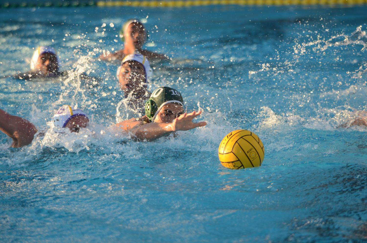 Varsity boys water polo captain Matthew Hajjar (12) reaches for the ball during a game against Monta Vista. The council  includes both junior varsity and varsity team leaders from all Harker sports.