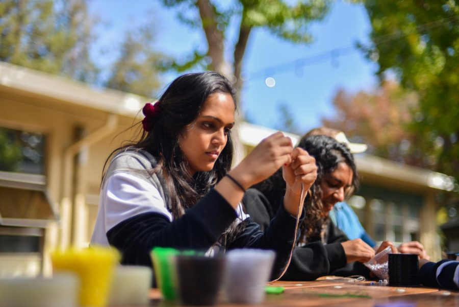 Junior Sejal Krishnan strings a bead onto a friendship bracelet at an activity hosted by spirit club today during lunch. Students are invited to participate in a number of spirit activities this week, including a parade and scream-off tomorrow after fifth period.