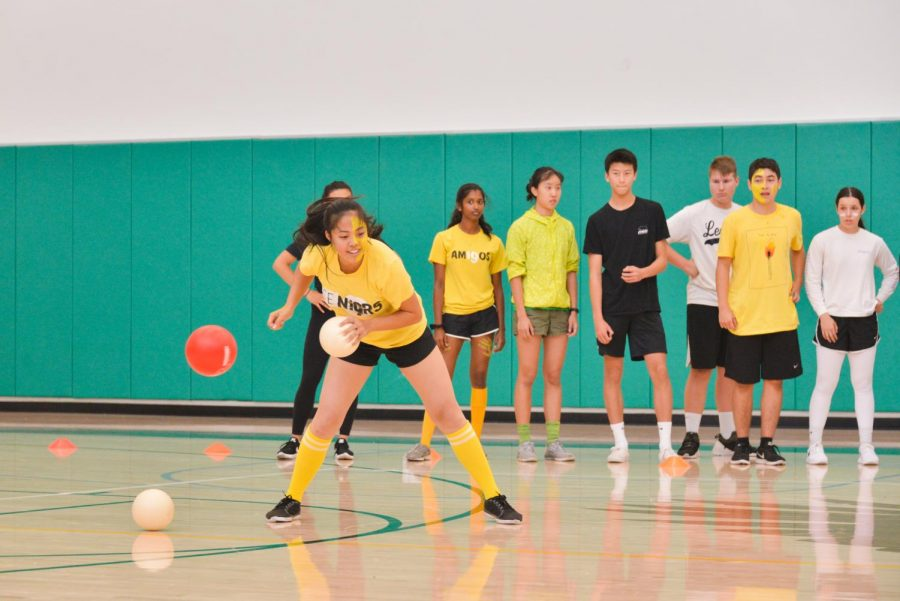 Taylor Lam (12) knocks away a ball during today's faculty-student dodgeball game, hosted by Spirit Club. The student team lost the game 2-1 after winning the first round.