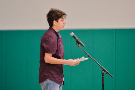 Raphael Sanche (12), GSA president, gives a speech about his experience coming out as transgender in honor of National Coming Out Day on Oct. 11.
