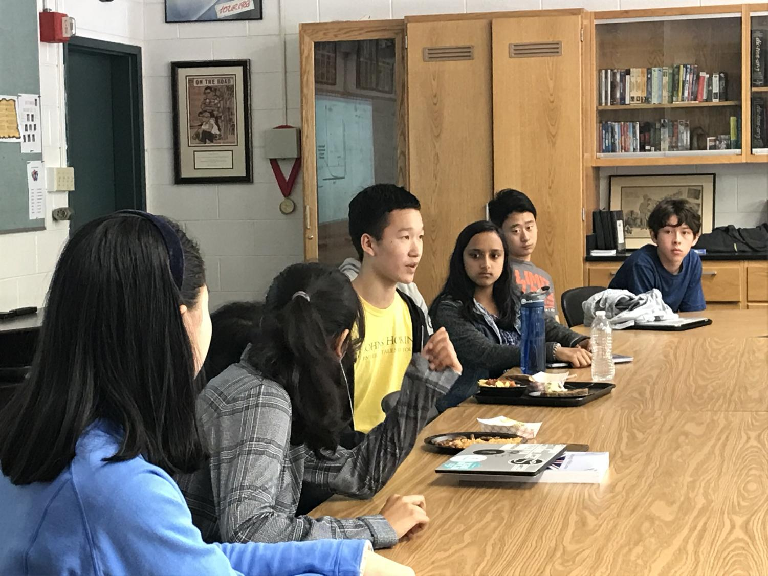 Six sophomores, including Ethics in Technology Forum co-founders Sidra Xu and Jason Lin, engage in discussion around a table. The first Ethics in Technology meeting was held on Sept. 27.