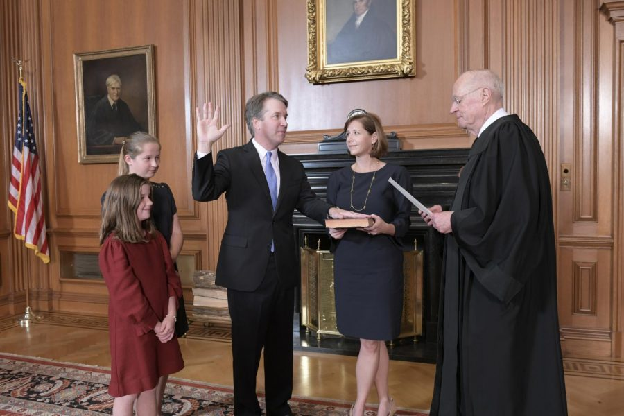 The+newly+confirmed+114th+Supreme+Court+Justice+Brett+Kavanaugh+takes+the+Constitutional+Oath%2C+administered+by+Chief+Justice+John+Roberts%2C+accompanied+by+Kavanaugh%27s+wife%2C+Ashley+Estes+Kavanaugh%2C+and+his+two+daughters%2C+Liza+and+Margaret.+The+Senate+confirmed+Kavanaugh%27s+nomination+in+a+50-48+today.