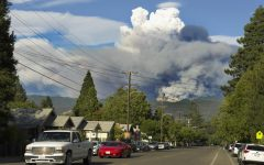 Billows of smoke rise from a forested mountainside over the city of Ukiah in Mendocino County. The Mendocino Complex Fire, which spanned across four northern California counties, was the largest recorded complex fire in California's history.