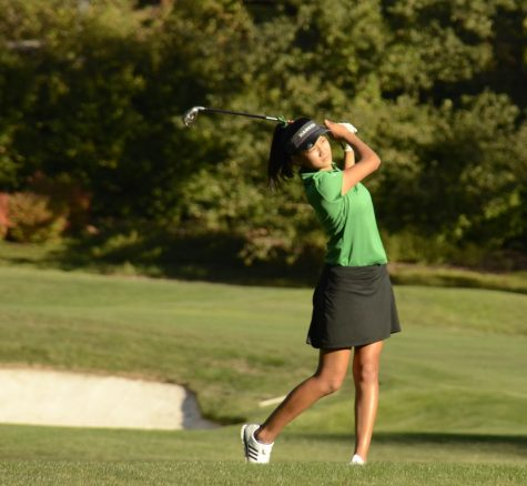 Olivia Guo (10) watches on after hitting the ball. Led by captain Katelyn Vo (11), the girls won a convincing 196-261 victory. Freshman Sophie Zhang Murphy shot par at 36, Katelyn followed with a 39 and Natalie Vo (10) and Olivia both shot 40.