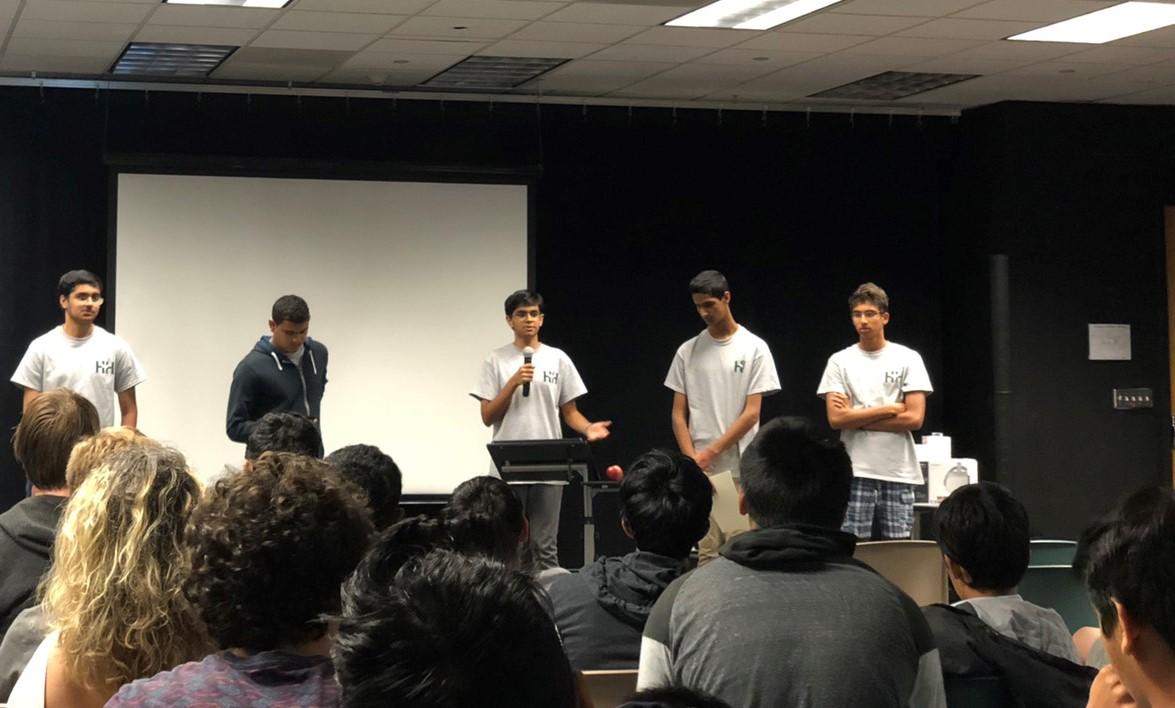 Nakul Bajaj (11) speaks during HarkerHacks with fellow officers Rohan Sonecha (11), Arnav Joshi (11), Arjun Akkiraju (11), and Arun Sundaresan (11). HarkerHacks 2018 took place from June 9 - 10 at 42 Silicon Valley.