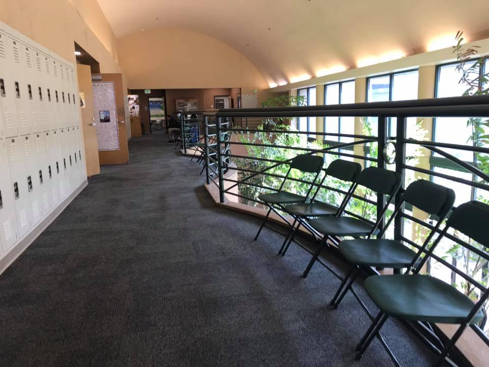 Chairs in the upstairs Dobbins hallway for parents and students attending conferences.