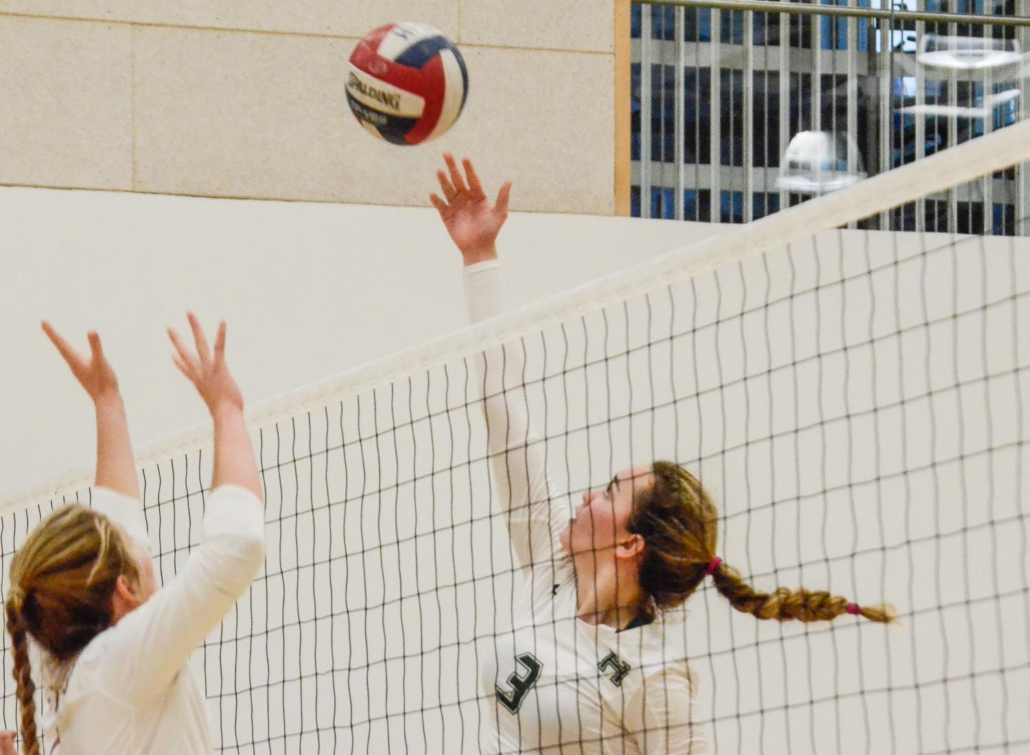 Lauren Beede (11) reaches up to tap the ball over the net in today's CCS semifinals game against Santa Cruz High School. The game was held at Menlo High School and was carried by the Harker varsity girls team, who will proceed to play Notre Dame High School in the finals game on Saturday.