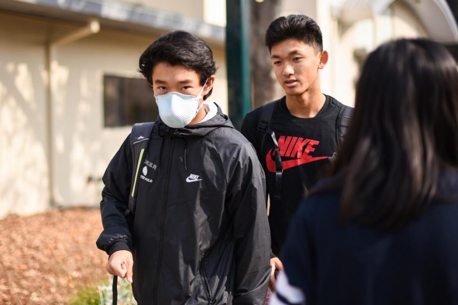 Daniel Wu (9) wears a mask to protect from the unhealthy air quality today during lunch.