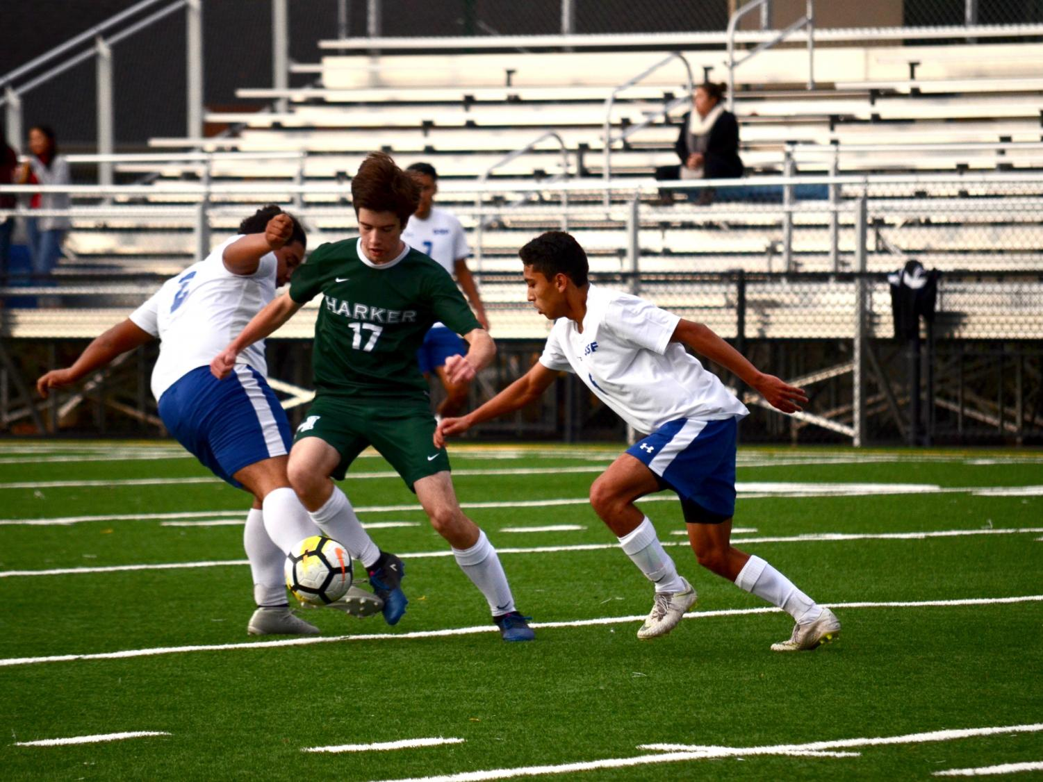Ryan Tobin (10) weaves through a pair of South San Francisco varsity players.