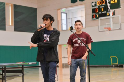 Spirit club officers Arjun Kilaru (12) and Zachary Hoffman (12) announce the results of the costume contests from Wednesday. Each winner received prizes as well as spirit points for their class.