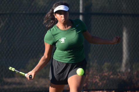 Singles player Santoshi Tirumala (10) prepares to hit the ball. Santoshi, along with doubles partners Gina Partridge (11) and Amanda Cheung (11), fell in Monday's quarterfinals.