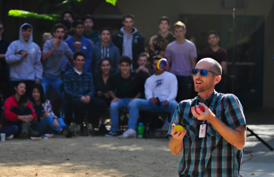 Staff photographer Mark Kocina performs his juggling act during Quadchella on Thursday.  The song
