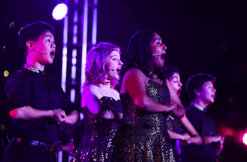 Downbeat members Neha Premkumar (12) and Kenya Aridomi (11) sing a rendition of