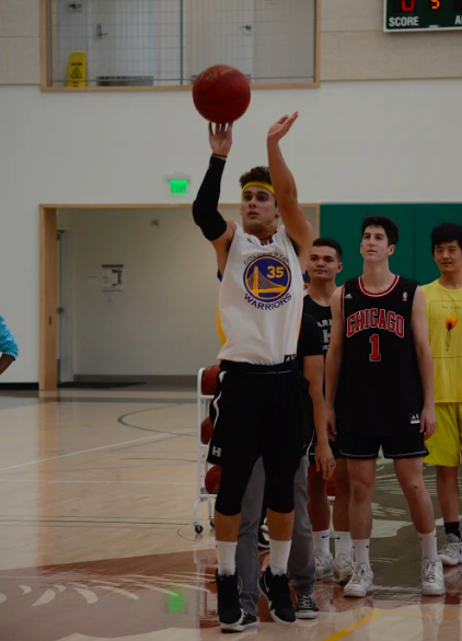 Mitchell Granados (12) shoots a basketball at the Hoops and Scoops fundraising event Nov. 27. The event was hosted to fundraise for MDA.