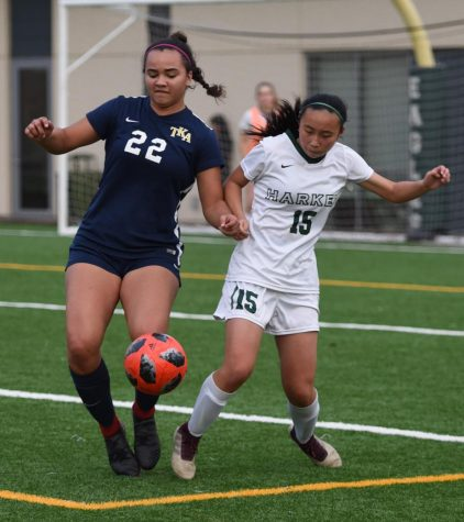 Kalyn Su (9) attempts to steal the ball away from an opposing player in a game against the Kings Academy Knights. The soccer team plays on Dec. 6 against Wilcox High at 4 p.m.
