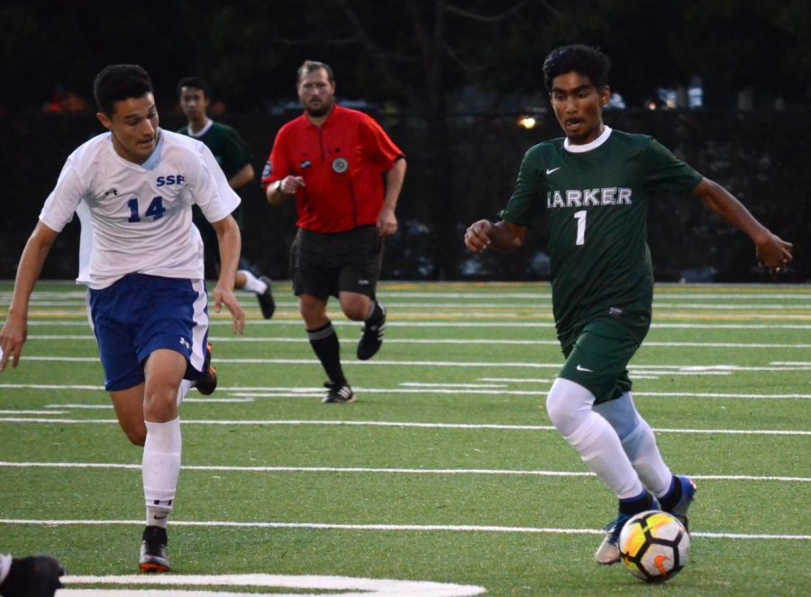Ishaan Mantripragada (9) dribbles the ball downfield as a St. Francis player chases after him. The Eagles lost the game 4-2.