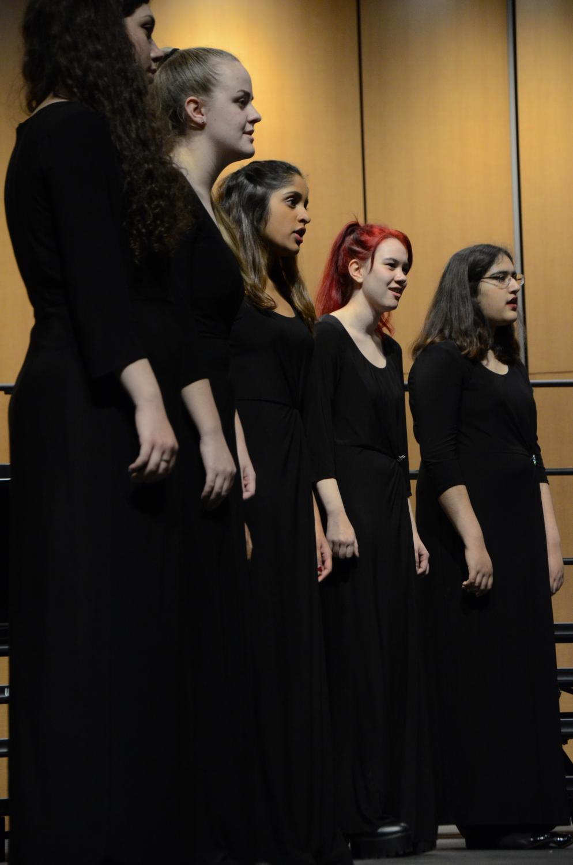 Cantilena members Karli Sharp (12), Marina Logue (12), Meghna Phalke (12), Hannah Eckert (12) and Tasha Moorjani (11) sing at the winter concert. The program included Cantilena, Camerata, Bel Canto and SUS4.