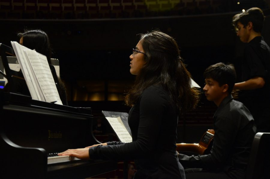 Ihita+Mandal+%2812%29+provides+piano+accompaniment+for+a+choral+group+in+this+year%27s+winter+concert.+Admission+was+free+to+the+concert%2C+held+on+Nov.+30+in+the+Rothschild+Performing+Arts+Center.