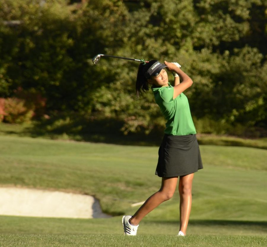 Olivia Guo (10) watches on after hitting the ball in a match against Sacred Heart Prep, which the Eagles won 196-261. Girls golf won the WBAL championship by an unprecedented margin of 44 strokes.