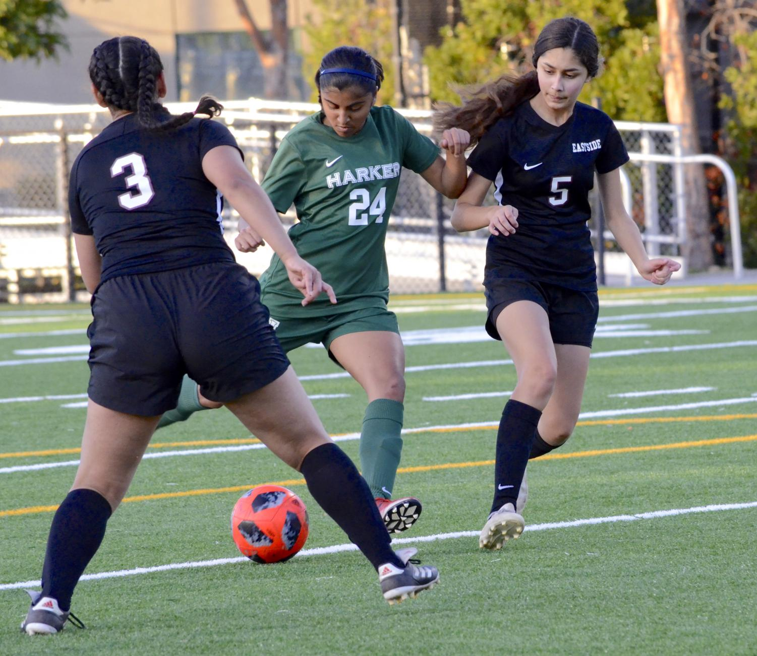 Megha Salvi (9) weaves through two Eastside players. The girls' next home game will be against Notre Dame on Jan. 12 at 10:30 a.m.