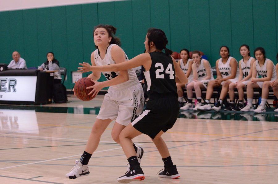Sara+Lynn+Sullivan+%2811%29+is+closely+guarded+by+a+Castilleja+defender.+The+Eagles+host+their+senior+night+on+Jan.+29+against+Mercy+Burlingame.