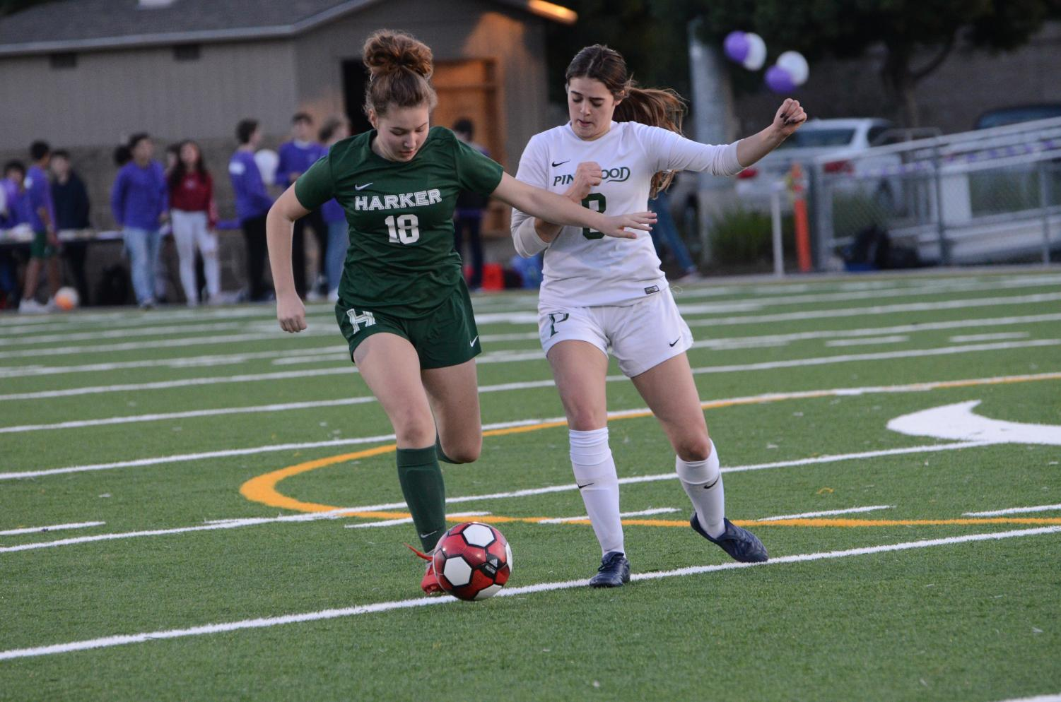 Kate Leafstrand (9) controls  the ball as a Pinewood player chases after her. The varsity girls won 5-0 against Pinewood.