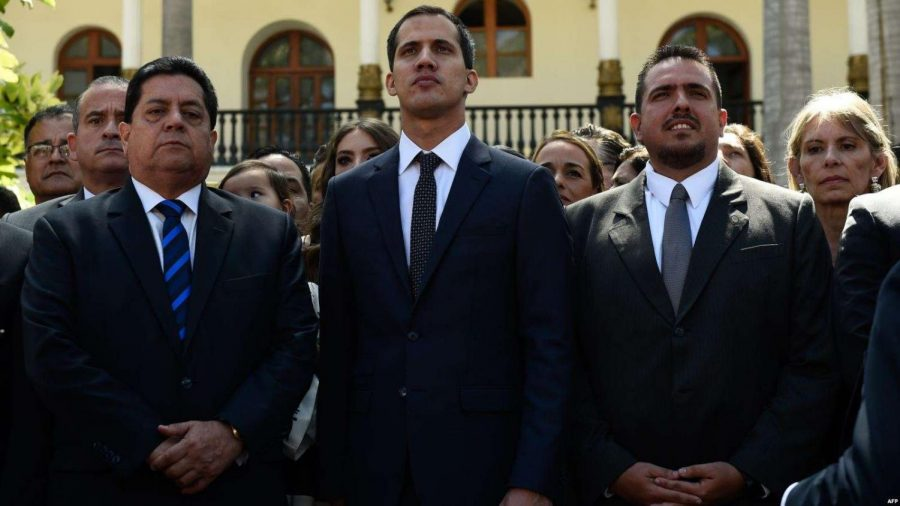 Juan+Guaido+stands+with+two+fellow+politicians%2C+Edgar+Zambrano+%28left%29+and+Stalin+Gonzales+%28right%29.+Guaido+declared+himself+Interim+President+of+Venezuela+on+Jan.+23%2C+sparking+massive+controversy+and+outcry+globally.+