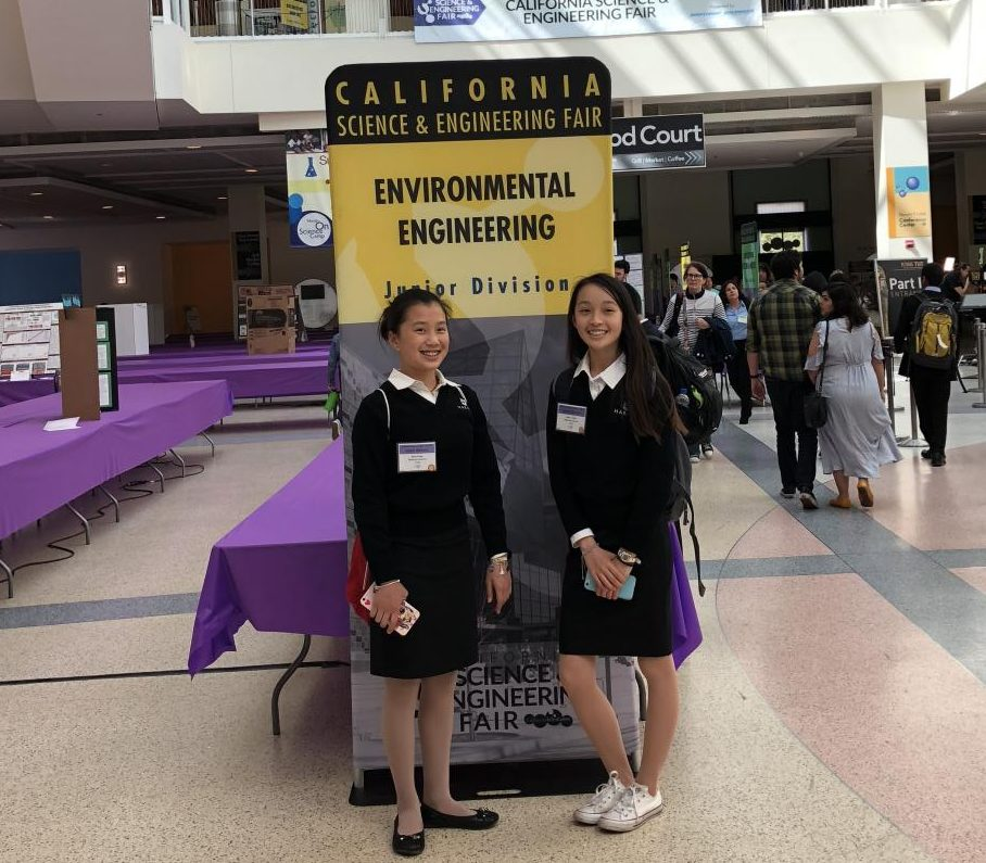 "Freshmen Alice Feng and Arely Sun stand in front of an Environmental Engineering poster at the 2018 California Science and Engineering Fair. Their project, which eventually won first place, was titled ""The Effect of Mushroom Species and Substrates on the Properties of a Novel Biodegradable Material: Mycelium."""