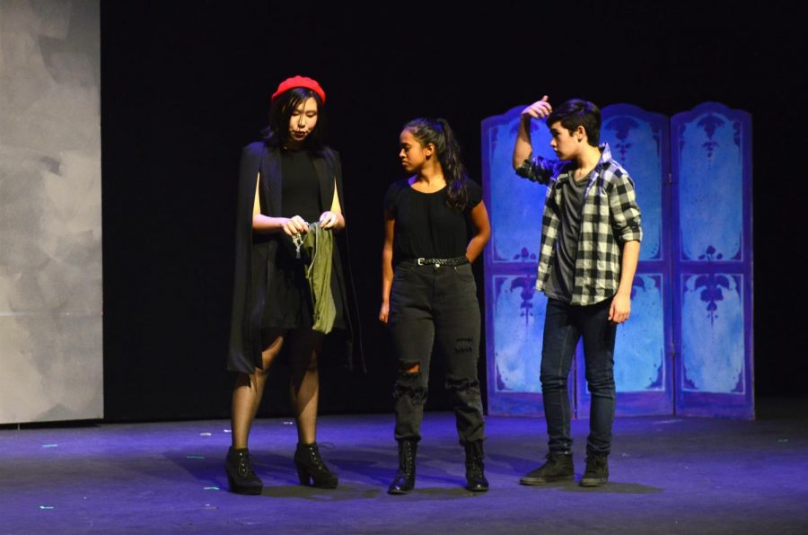 Sarah Raymond (10), who plays the character Miriam, shows a bag to Lisa Barooah (10), playing Olivia, and Joel Morel (11), playing Cody. In