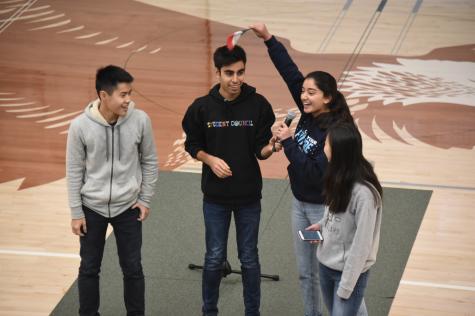 Members of junior class council Evan Cheng, Avi Gulati, Roma Gandhi and Alyssa Huang announce the theme,