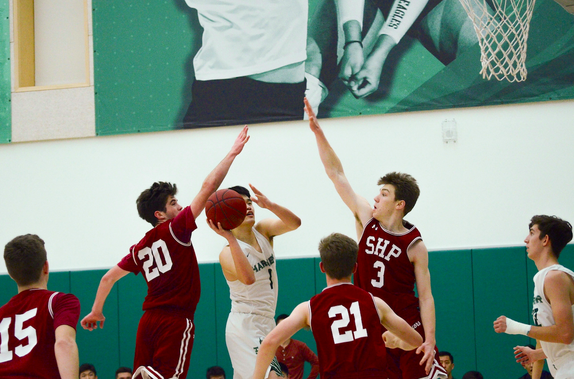 Gene Wang (12) scores in traffic. The Eagles next play at Crystal Springs on Tuesday, Jan. 29 at 7:30 p.m.