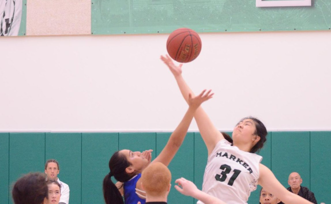 Kaitlyn Dai (11) gains possession of the ball at the jump ball at the beginning of the game. The girls play at Castilleja on Tuesday at 5:30 p.m.