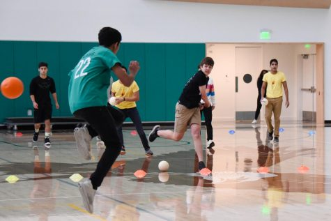 Senior dodgeball players threw foam balls at freshman players, defeating them in the final game of the dodgeball tournament.