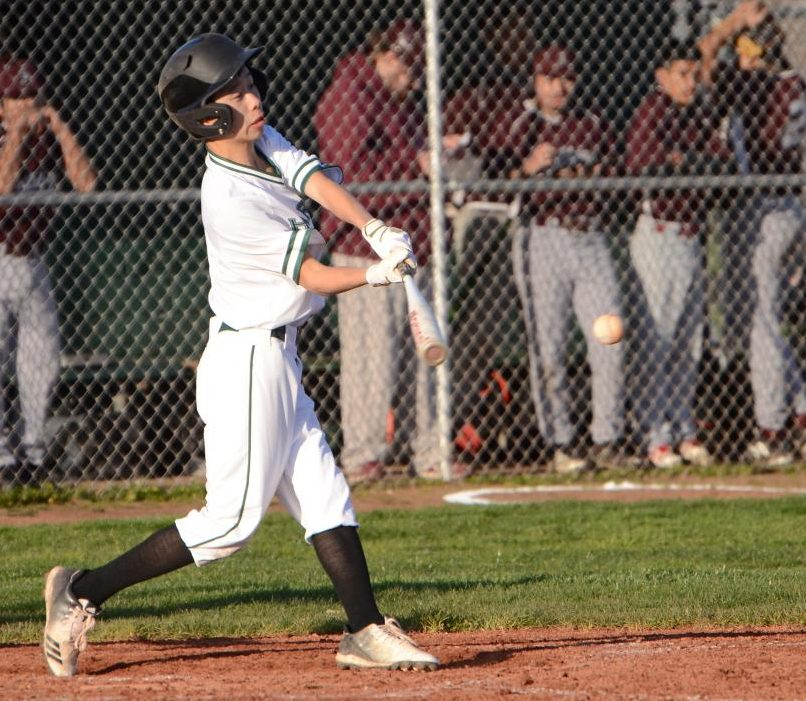 Austin Wang (9) swings at a pitch. The boys next play at Prospect High School next Wednesday at 3:30 p.m.