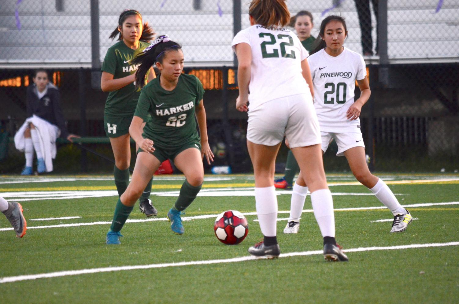 Aria Wong (10) weaves through a pair of Pinewood defenders. The varsity girls won 5-0.